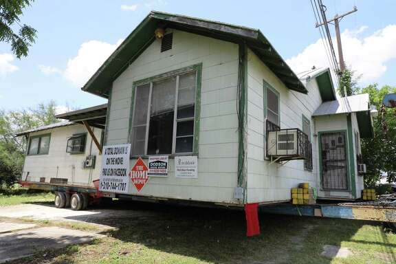 The 1925 house awaits its move from one side of IH-35 near downtown to the other. Once renovated, it may someday house a law office, a hair salon or even a restaurant.