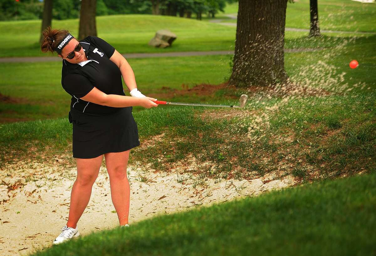 Trumbull's Taylor Brown hits from a green side bunker on the 4th hole of the 2018 FCIAC Golf Championships at Fairchild Wheeler Golf Course in Fairfield, Conn. on Thursday, May 31, 2018.