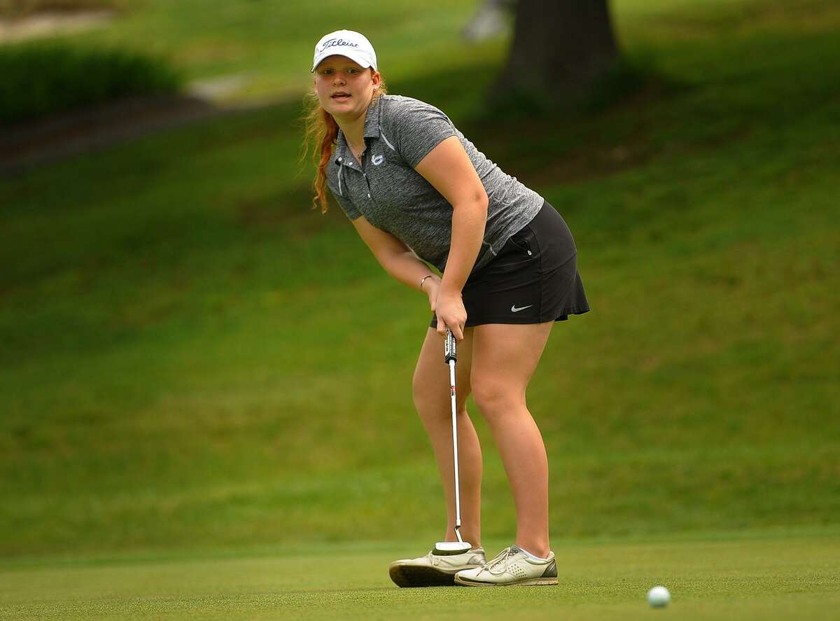 New Canaan's Meghan Mitchell putts on the 2nd hole of the FCIAC Golf Championships at Fairchild Wheeler Golf Course in Fairfield on Thursday.
