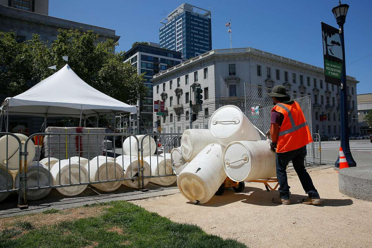Workers setting up for the upcoming Clusterfest festival in Civic Center Plaza in San Francisco, Ca., on Tues. May 29, 2018. A bond measure is on the ballot that would fund city park improvements and maintenance.