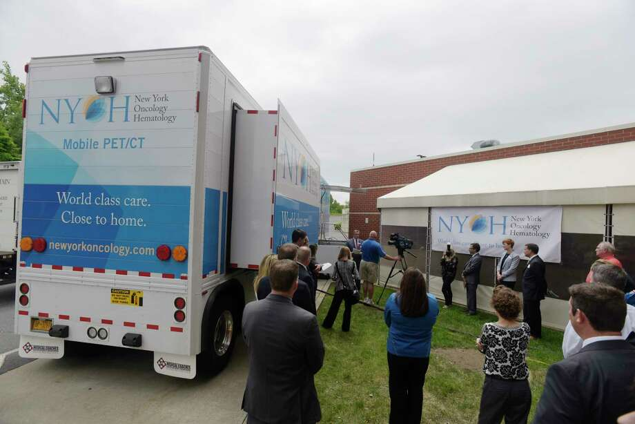 People gather for a press event to unveil the New York Oncology Hematology mobile PET/CT truck on Thursday, May 31, 2018, in Albany, N.Y. NYOH invested more than $1.5 million in the mobile PET/CT. The mobile truck is being used to provide PET/CT scans for patients in Albany, Amsterdam, Clifton Park, Hudson, and Schenectady.   (Paul Buckowski/Times Union) Photo: PAUL BUCKOWSKI / (Paul Buckowski/Times Union)