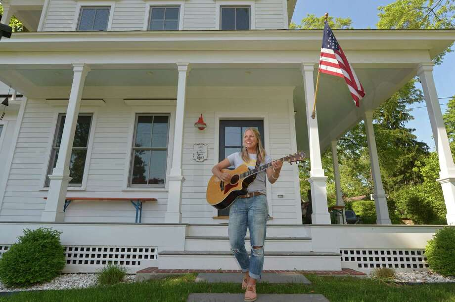 Dre Towey founder of JAM Studio at her home on Pennoyer Street Thursday, may 24, 2018, in Norwalk, Conn. Towey is launching a porch festival fundraiser where sixteen bands will perform on sixteen porches throughout Rowayton on June 2. Photo: Erik Trautmann / Hearst Connecticut Media / Norwalk Hour