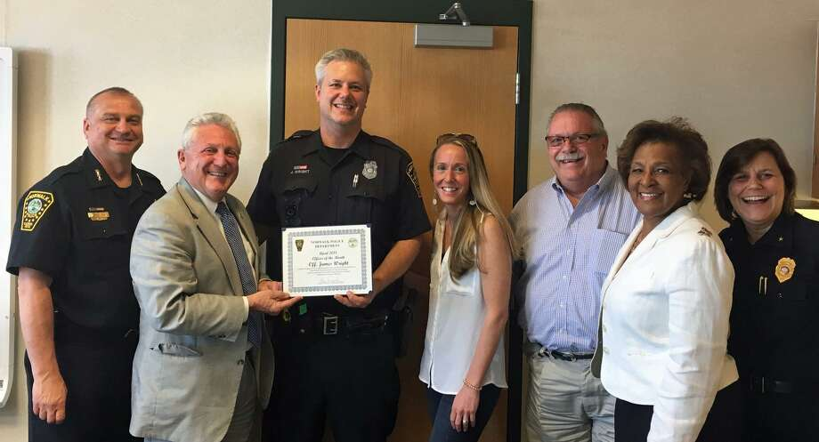 Norwalk's Officer of the Month Jamie Wright, center, holding certificate. Photo: Contributed Photo / Norwalk Police Department /