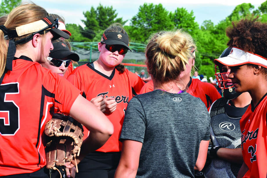 Edwardsville assistant coach Caty Ponce talks to members of the softball team during the Class 4A Pekin Sectional semifinals against Belleville East on Tuesday.