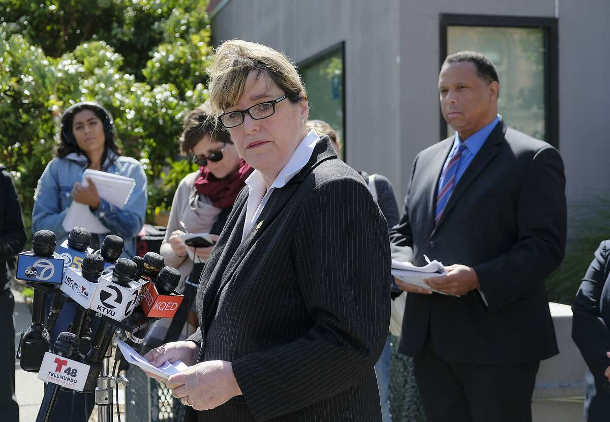 San Francisco Sheriff Vicki Hennessy makes a statement about a woman who was found dead Wednesday in a stairwell of a power plant, during a news conference outside Zuckerberg San Francisco General Hospital Thursday, May 31, 2018, in San Francisco. At right is Roland Pickens of the San Francisco Health Network. Officials say an elderly woman with dementia who was found dead in a stairwell of a power plant on a San Francisco hospital campus had checked herself out of a nearby care facility. Sheriff Hennessy said Ruby Andersen left the care facility across the street from Zuckerberg San Francisco General Hospital on May 19 to visit her family. She was not a hospital patient. (AP Photo/Eric Risberg)