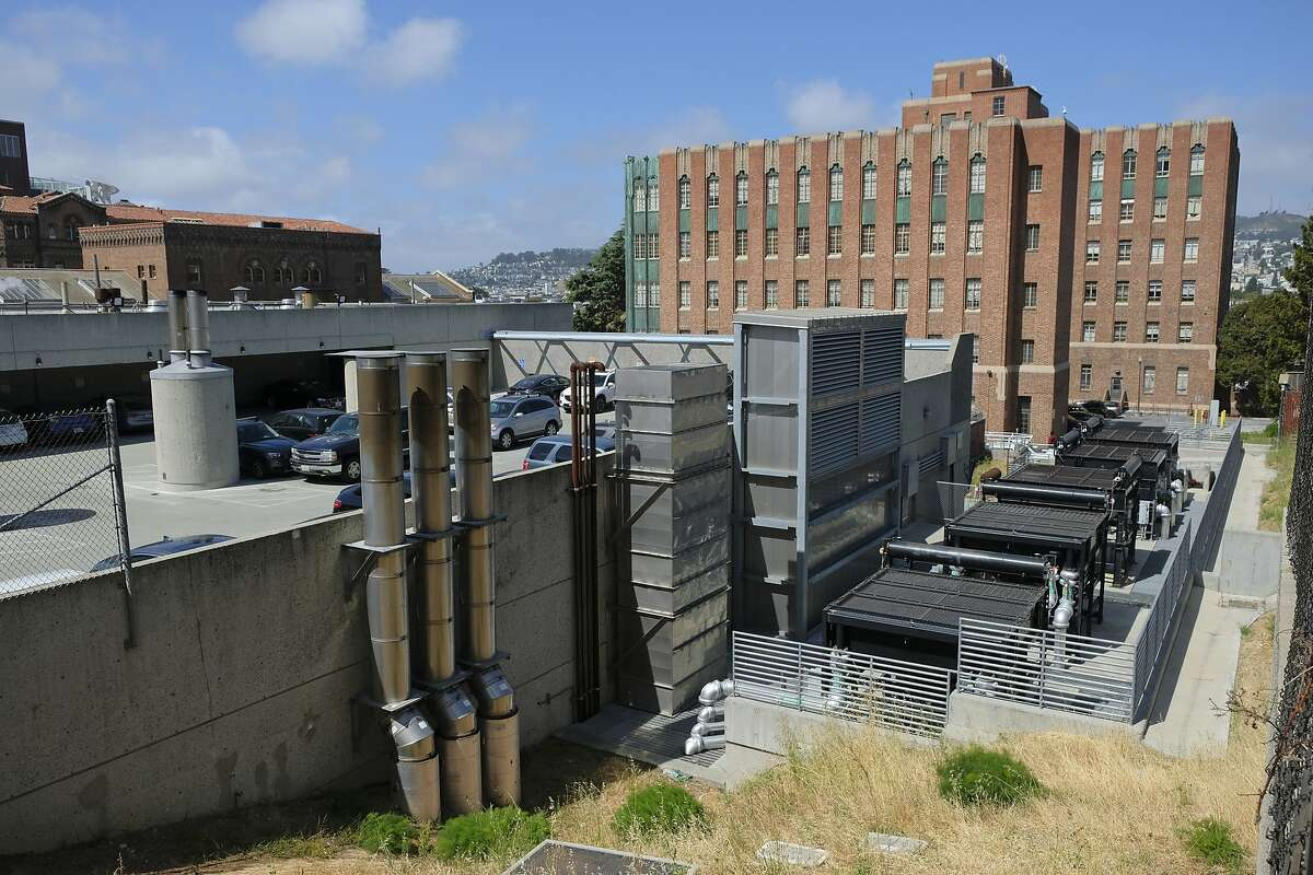Shown is a power plant building on the Zuckerberg San Francisco General Hospital campus in San Francisco Thursday, May 31, 2018, where a woman was found dead Wednesday in a stairwell. Officials say an elderly woman with dementia who was found dead in a stairwell of a power plant on a San Francisco hospital campus had checked herself out of a nearby care facility. San Francisco Sheriff Vicki Hennessy says Ruby Andersen left the care facility across the street from Zuckerberg San Francisco General Hospital on May 19 to visit her family. She was not a hospital patient. (AP Photo/Eric Risberg)