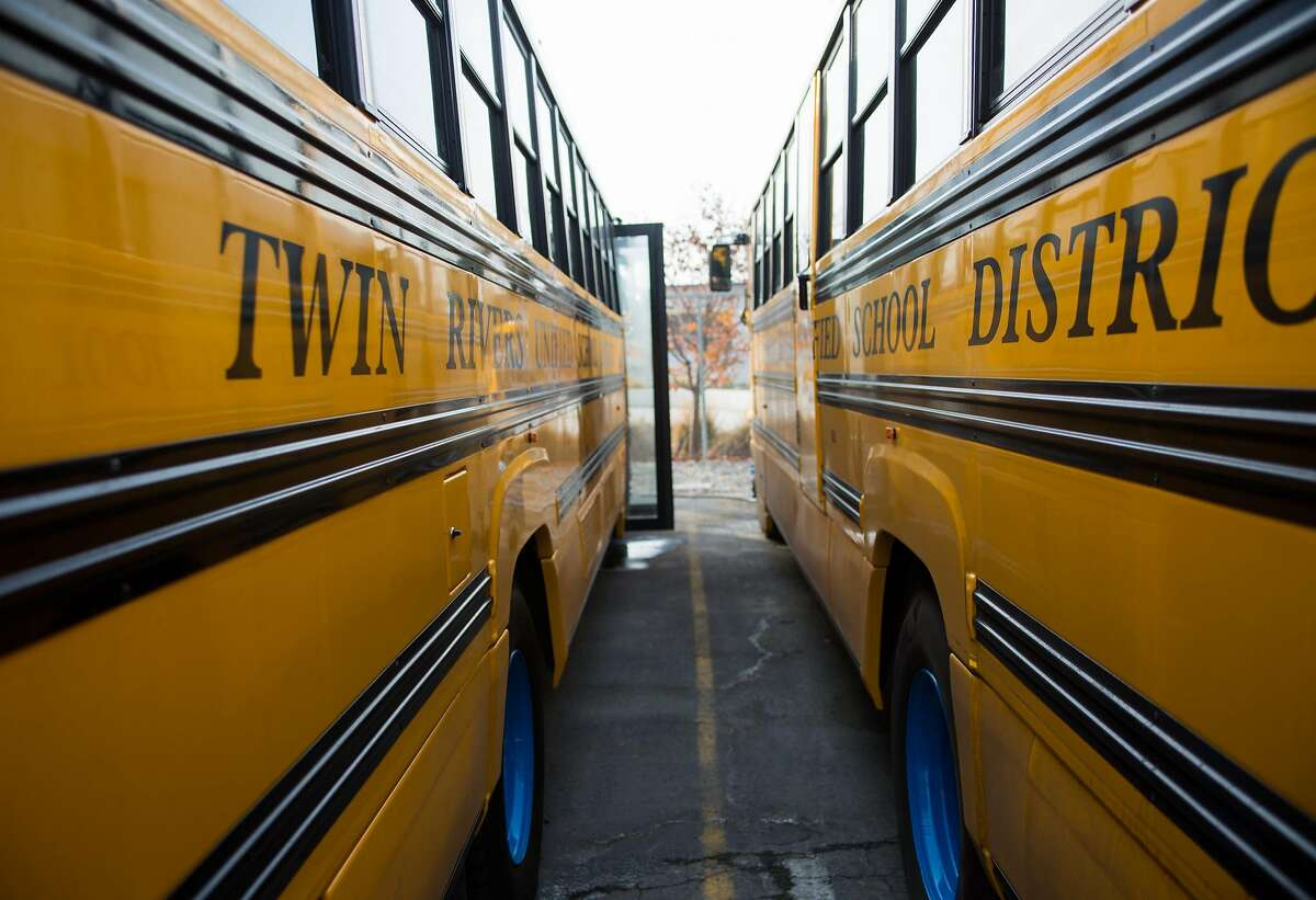 Electric school buses charge at the transportation services station in Sacramento, California, Friday, December 15, 2017. The buses require several hours to obtain a full charge and are plugged in immediately after a route.