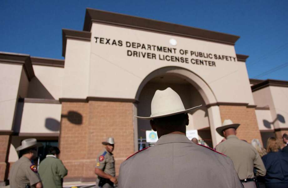 A Texas Department of Public Safety trooper in front of the new Texas DPS Spring Drivers License Mega Center at 4740 Spring Cypress Road. When changing your address, voter registration should come automatically — the subject of litigation at the moment. Photo: /Staff Photo By Eric Swist / Staff photo by Eric Swist