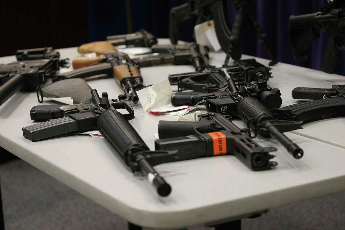 A reader equates what author Margaret Atwood said about axes to guns and the Second Amendment. Here, illegal weapons confiscated by police are displayed at Chicago police headquarters on May 10.