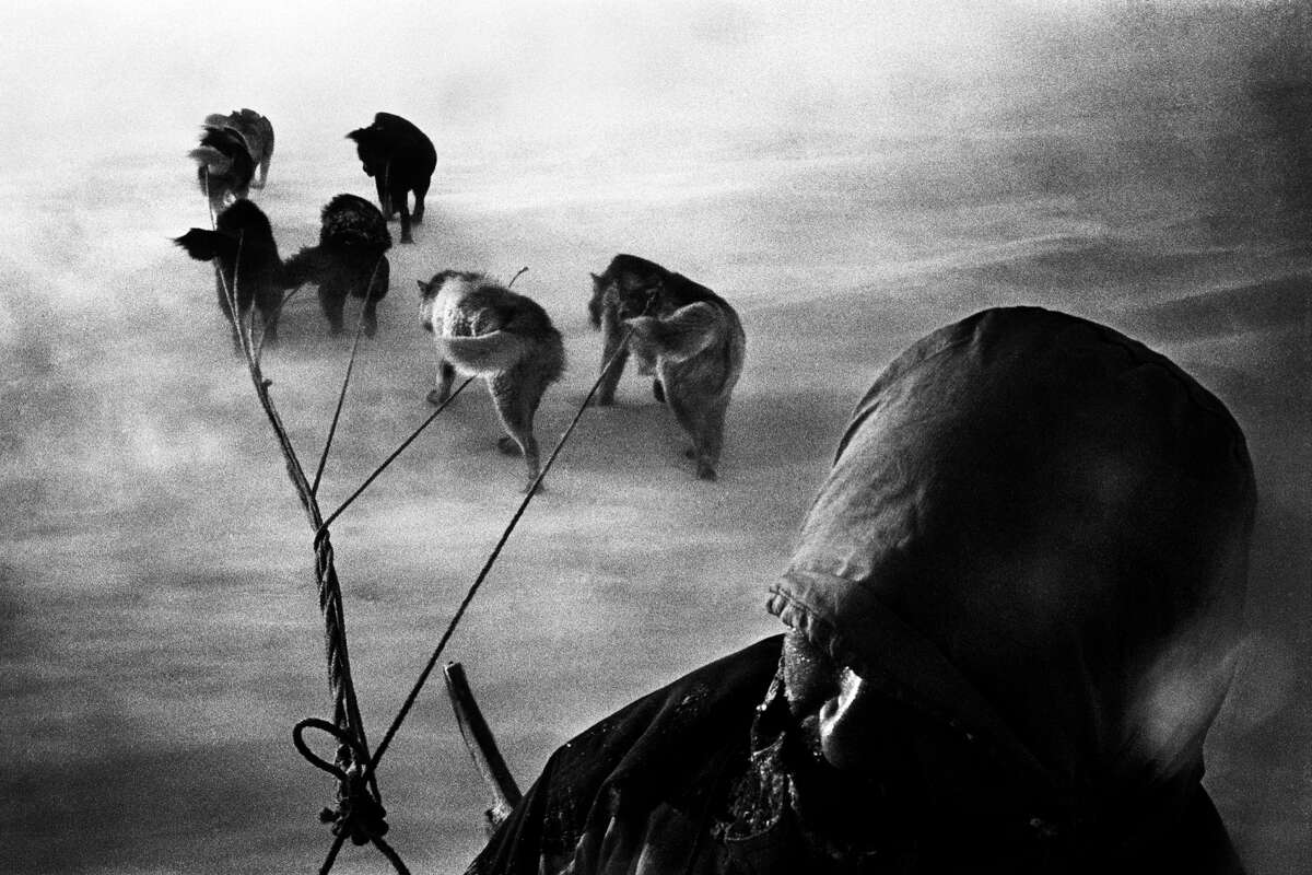 Jacob Aue Sobol - A hunter and his dogsled caught in a snowstorm on their way home. Tiniteqilaaq, Greenland, 2000. Quote: