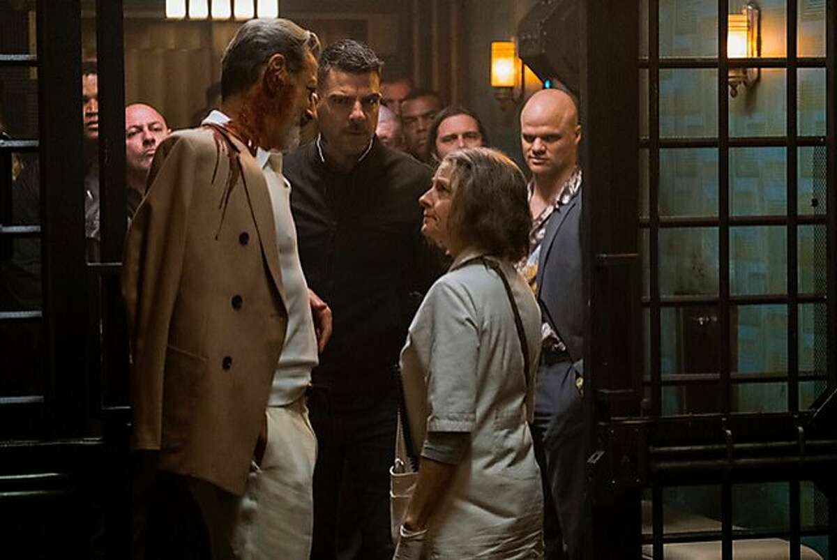 Jeff Goldblum (left) and Zachary Quinto consult with a nurse (Jodie Foster) who specializes in discreetly treating injured criminals, in