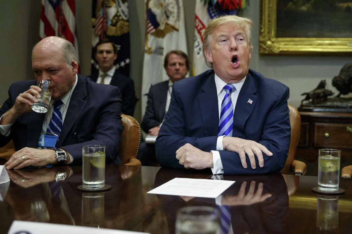 Ford CEO James Hackett listens as President Donald Trump speaks during a meeting with automotive executives in the Rosevelt Room of the White House, Friday, May 11, 2018, in Washington.