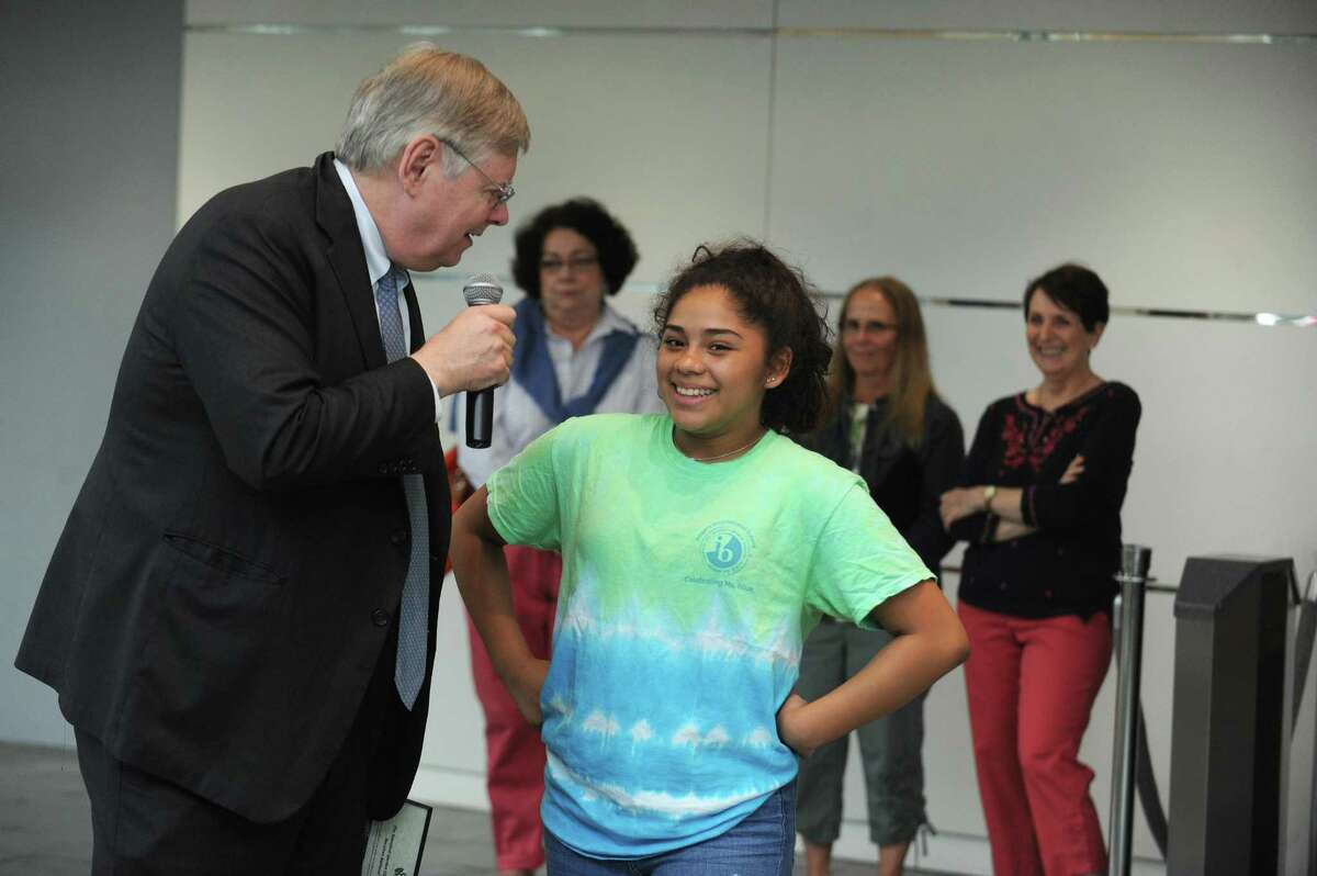 13-year-old Greissy Najera Coy smiles while talking to Stamford mayor David Martin during ceremony recognizing the participants of the 2018 Stamford Public School Lettuce Challenge inside Government Center in downtown Stamford, Conn. on Thursday, May 31, 2018. Najera Coy won first place for her lettuce.