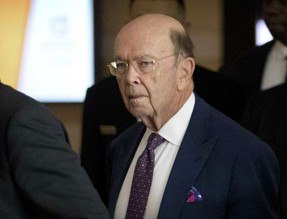 In this May 4, 2018, file photo, U.S. Commerce Secretary Wilbur Ross leaves his hotel in Beijing. China announced Thursday evening that it would cut tariffs sharply July 1 for an eclectic array of imported goods, the latest in a series of moves by Beijing to dismantle steep trade barriers at a time of rising frictions with the United States. The tariff cuts came less than two days before Ross is due in Beijing for wide-ranging talks aimed at addressing U.S. frustrations with China's $375 billion bilateral trade surplus with the United States. Photo: Mark Schiefelbein /Associated Press / Copyright 2018 The Associated Press. All rights reserved.