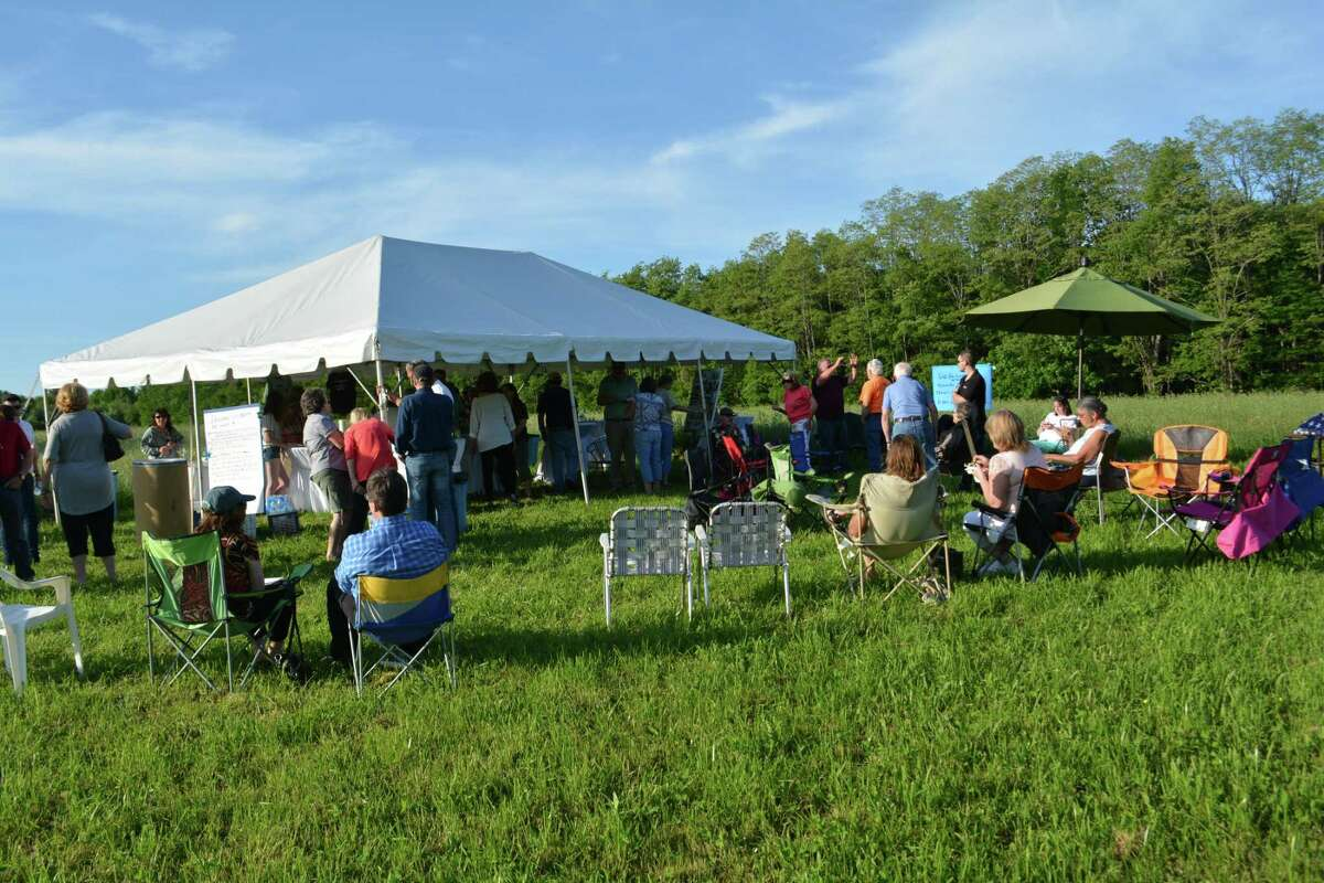 Members of the Winchester Land Trust gathered Wednesday night at their newest property on the Torrington city line to dedicate the Michael Giordano Tribute Area.