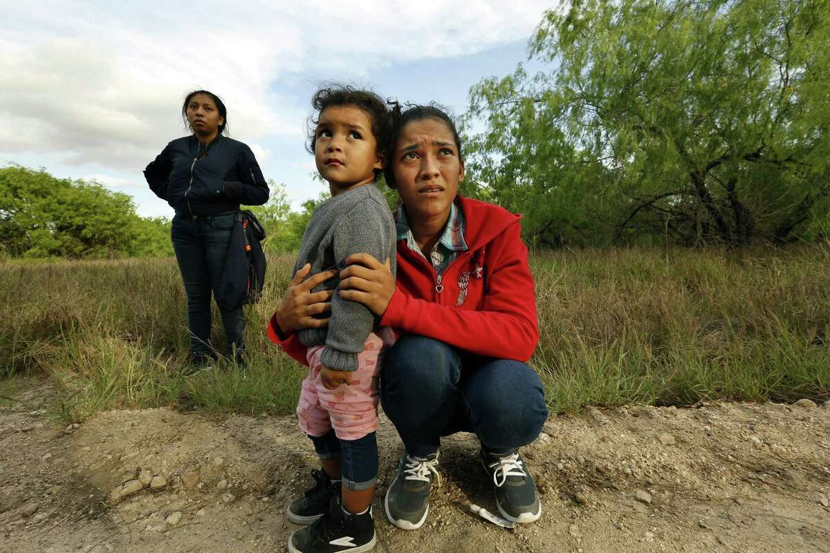 Lirio Funes, 20, holds onto her daughter Melissa Funes, 2, just after being detained by local officials after crossing the U.S. - Mexico border on March 15, 2018 in McAllen, Texas.