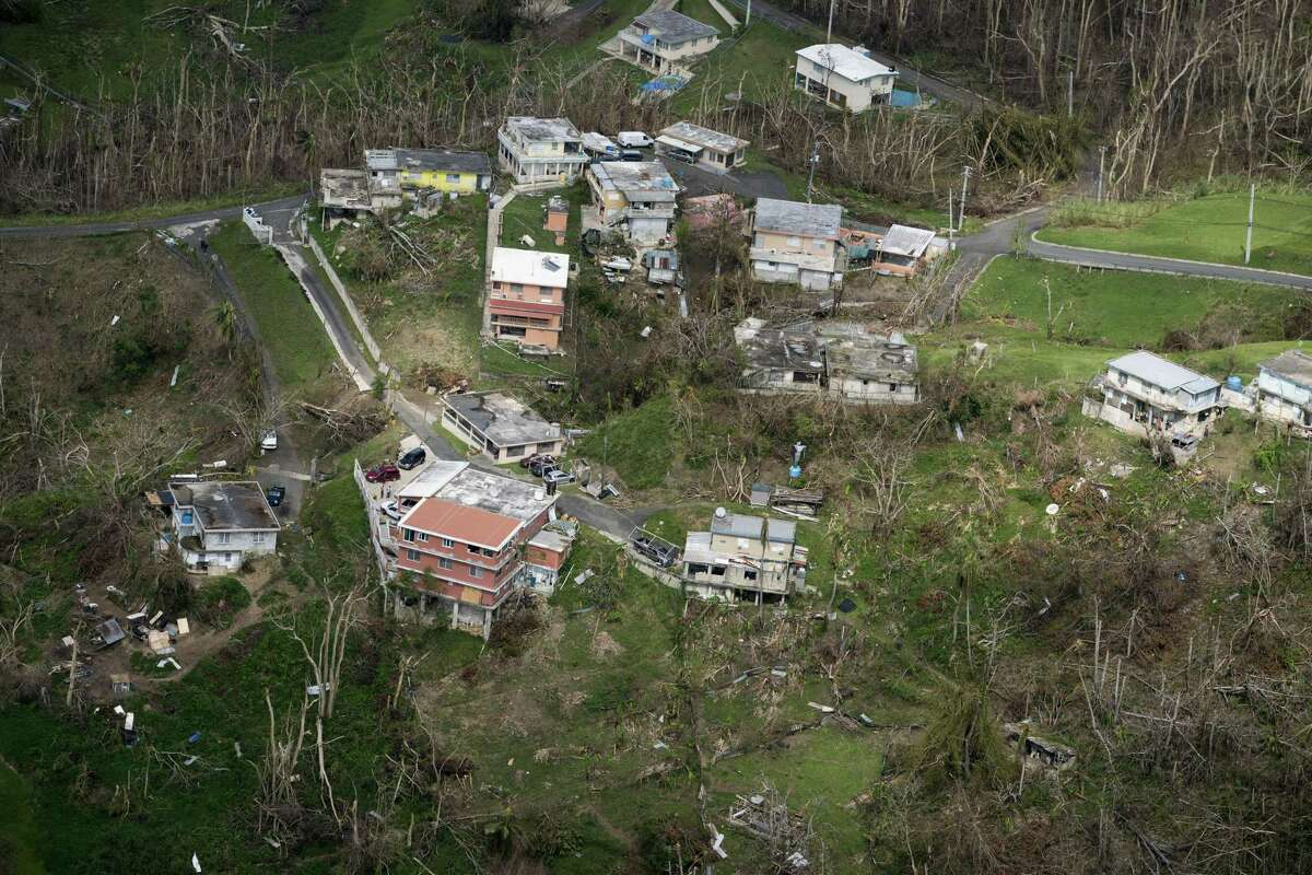 Homes damaged during Hurricane Maria, seen during Donald Trumps visit to the San Juan, Puerto Rico, Oct. 3, 2017. A new study by a group of independent researchers at Harvard University concludes that the hurricane caused roughly 4,600 deaths, many of them due to delayed medical care.