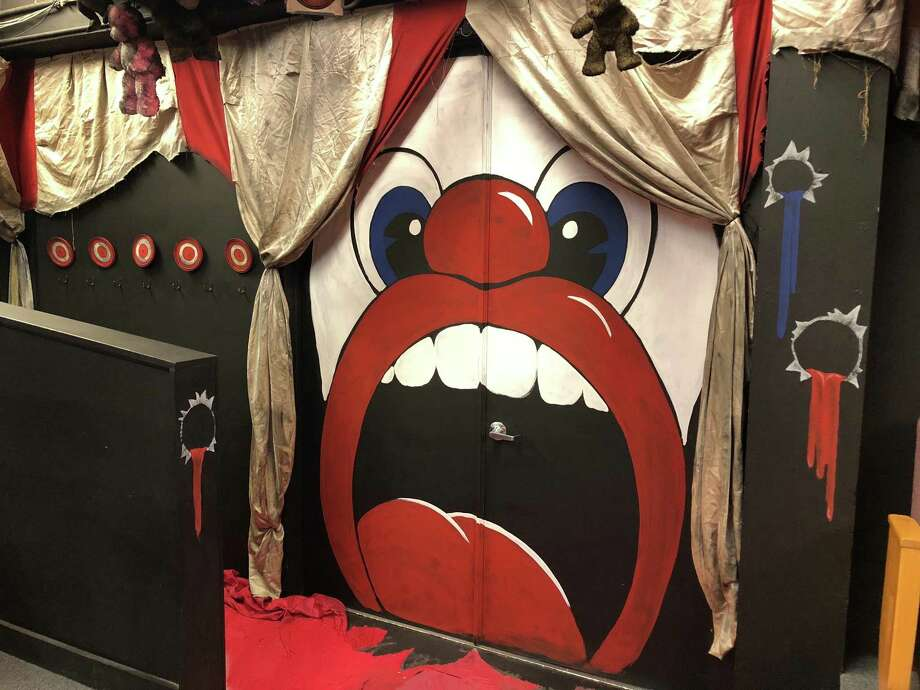 "Jeremy Whittington designed the set for The Public Theater of San Antonio's staging of ""Assassins."" All of the entry points — including the door to the Cellar Theater space — have been masked in ways that evoke carnival attractions and decor. Photo: Courtesy Jeremy Whittington /"