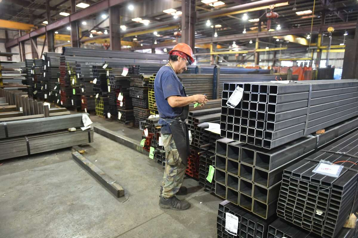 Chuey Martinez prepares materials to be moved at Alamo Iron Works in San Antonio. President Trump has proposed a higher import tariff foreign steel.