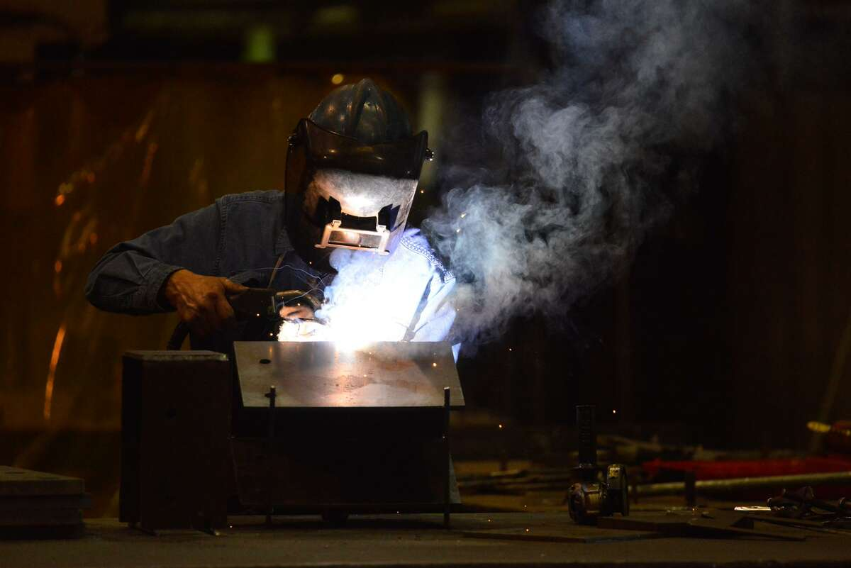 Maurice Flores welds at Alamo Iron Works in San Antonio. President Trump has proposed a higher import tariff foreign steel.
