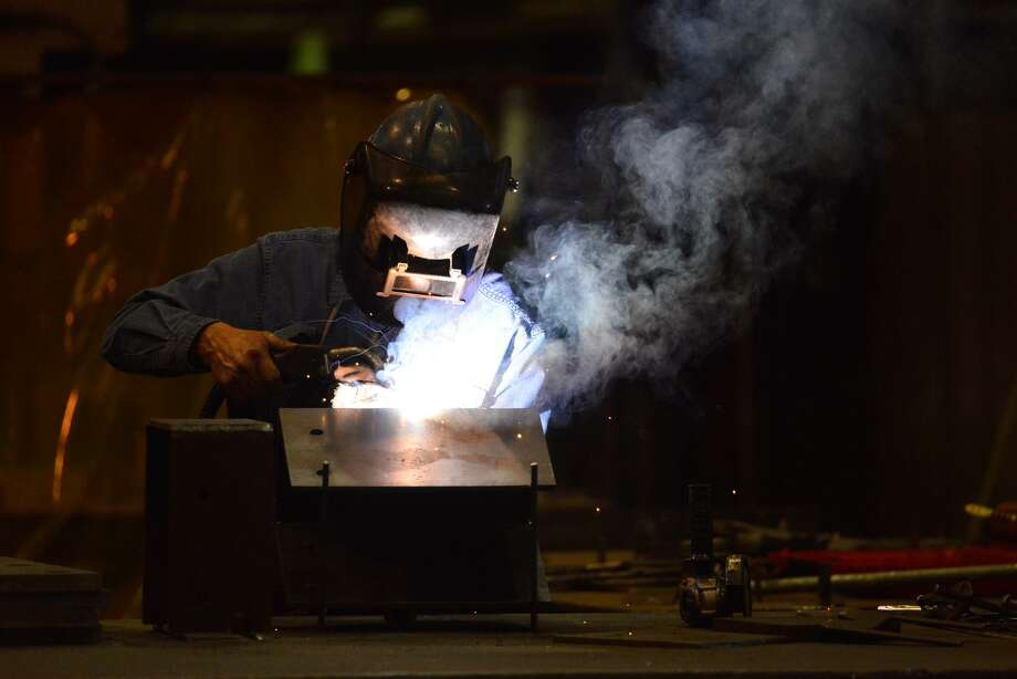 Maurice Flores welds at Alamo Iron Works in San Antonio. President Trump has proposed a higher import tariff foreign steel. Photo: Robin Jerstad, Freelance / San Antonio Express News