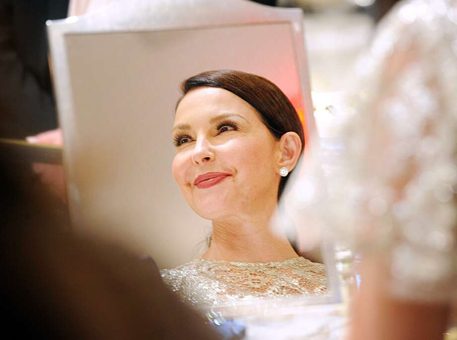 Ashley Judd smiles in a reflection in a jeweler's mirror during the Greenwich International Film Festival Changemaker Gala at Betteridge Jewelers Thursday. Photo: Bob Luckey Jr. / Hearst Connecticut Media / Greenwich Time