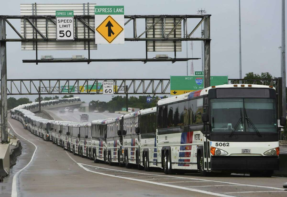 As a preventative measure, empty Metropolitan Transit Authority buses are lined up in the center lanes of Interstate 69 near Cavalcade prior to Hurricane Harvey on Aug. 26, 2017, in Houston. The HOV lanes also play a critical role in future transportation plans.