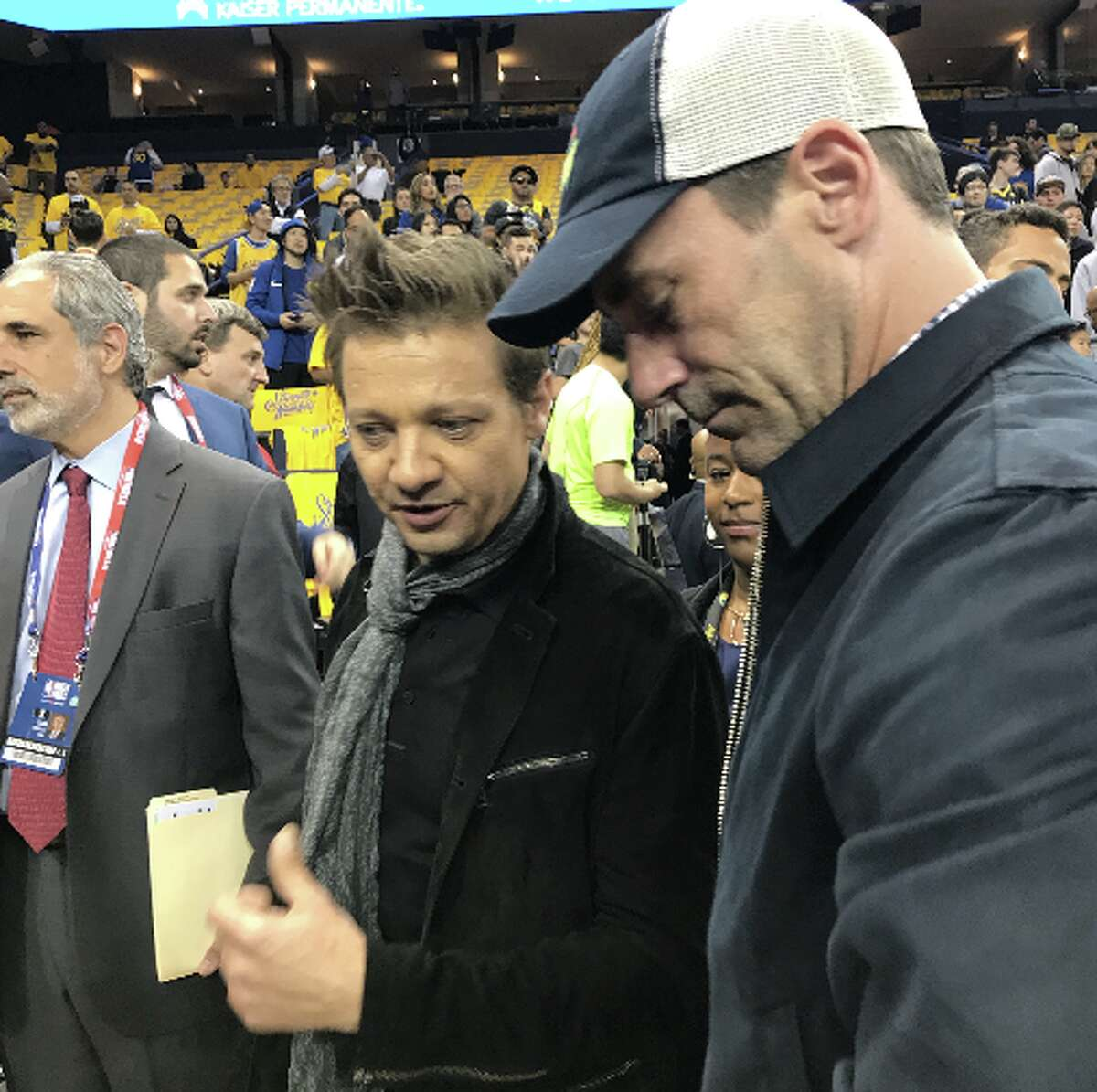 Actors Jeremy Renner and Jon Hamm prior to Game 1 of the 2018 NBA Finals between the Golden State Warriors and the Cleveland Cavaliers at ORACLE Arena on May 31, 2018 in Oakland, California.