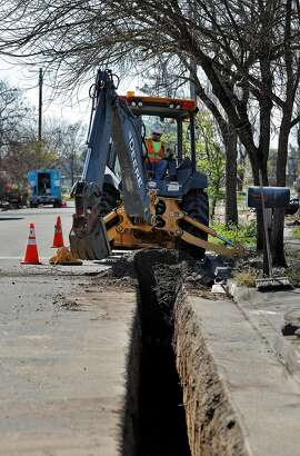 A PG&E worker uses a excavator to remove dirt from a new trench as PG&E crews and subcontractors began prepping for underground utility lines in the Coffey Park neighborhood of Santa Rosa, Calif., on Monday, April 2, 2018. The neighborhood was devastated by fire in October as dozens of residents perished when thousands of homes in the region were destroyed in the North Bay fires in the region.