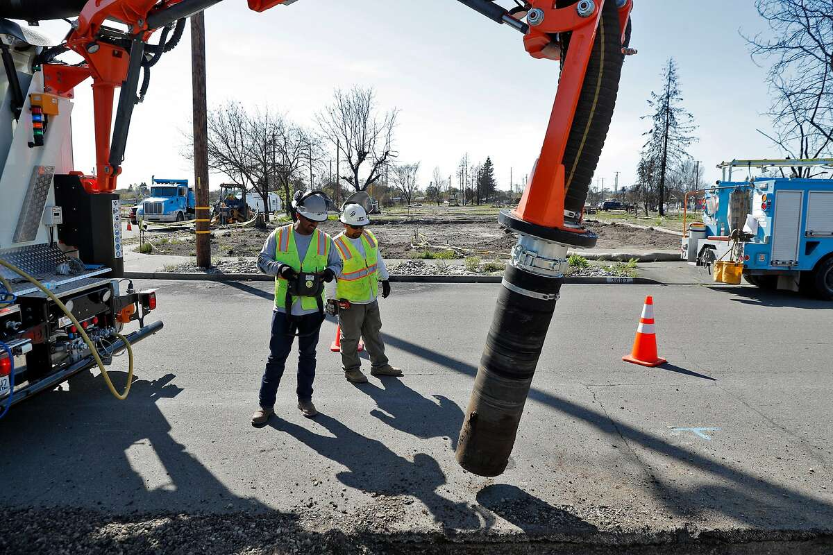 A BTI Environmental contractor works on a trench next to empty home lots as PG&E crews and subcontractors began trenching for utility lines in the Coffey Park neighborhood of Santa Rosa, Calif., on Monday, April 2, 2018. The neighborhood was devastated by fire in October as dozens of residents perished when thousands of homes in the region were destroyed in the North Bay fires in the region.