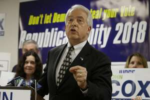 FILE - In this May 23, 2018, file photo, Republican gubernatorial candidate John Cox address supporters at the Sacramento County Republican Party headquarters in Sacramento, Calif. The heat for California governor is especially intense for Republican Cox and Democrat Antonio Villaraigosa, whom polls show to be in a tough fight for the second of two slots on the general election ballot. Democrat Gavin Newsom is the undisputed front-runner and is expected to advance. The primary is Tuesday, June 5, 2018, and more than 1.4 million ballots have already been cast by mail. (AP Photo/Rich Pedroncelli, File)
