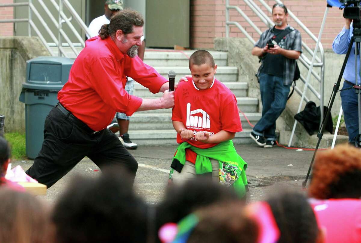 Roberto Falcon, right, resists being pushed by Terry Neu as hundreds of kids attend an Anti-Bullying & Anti-Violence Youth Rally held at Hall Neighborhood House in Bridgeport, Conn., on Thursday, May 31, 2018. Congressman Jim Himes joined the rally to help discuss steps that students, parents, schools, and community leaders can take to create safe school environments and build community-wide strategies to help prevent bullying.