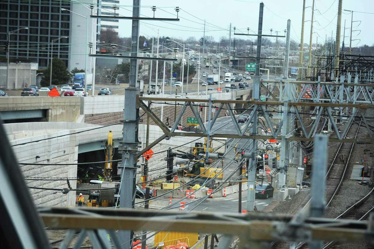 Construction workers continue the first phase of the Atlantic Street Bridge Project on South State St. in downtown Stamford, Conn. on Tuesday, March 27, 2018. The work, happening near I-95 Exit 8, is the first phase of a larger project to rebuild the railroad bridge that crosses over Atlantic Street.