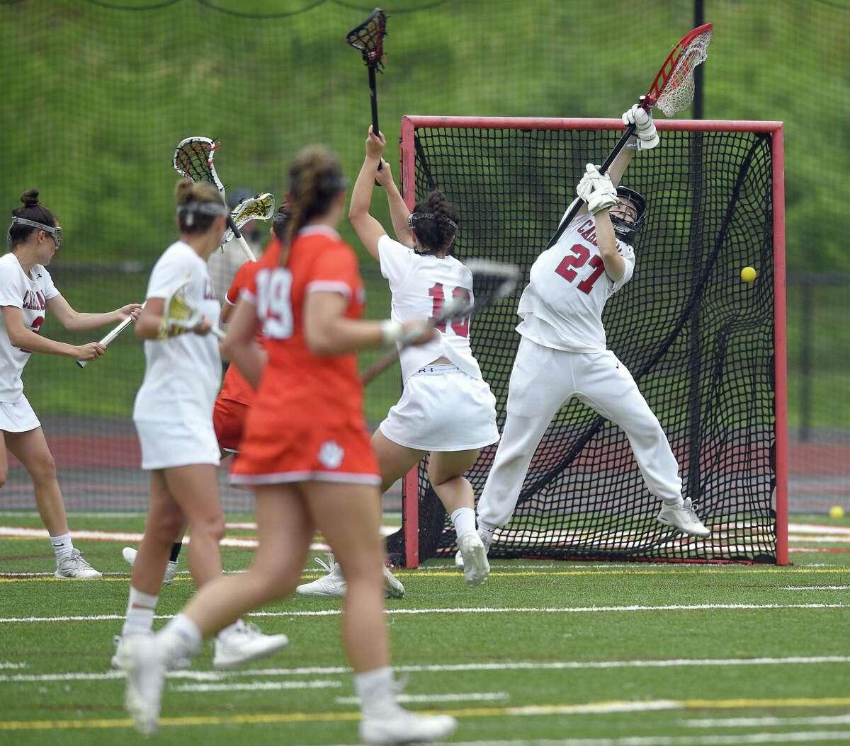 Greenwich goalie Sloane Loveless is scored onl by Ridgefield Caitlin Slaminko (4) in a CIAC Class L girls lacrosse quarter final game at Cardinal Stadium on May 31, 2018 in Greenwich, Connecticut. Ridgefield defeated Greenwich 7-6.