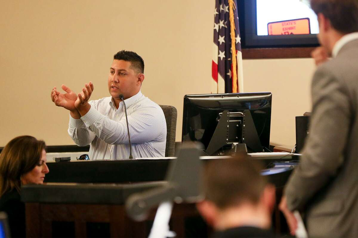 Prosecutor Josh Somers (right) watches as Dennis Austin demonstrates to the jury how he recalls Jose Luis Menchaca was bound before being murdered during the third day of testimony in the retrial of Daniel Lopez in the 379th state District Court at the Cadena-Reeves Justice Center on Wednesday, May 30, 2018. Lopez is accused with two others of beating, dismembering and burning body parts of Menchaca, his girlfriend's cousin, in retaliation over a stabbing in a drug deal gone bad. MARVIN PFEIFFER/mpfeiffer@express-news.net