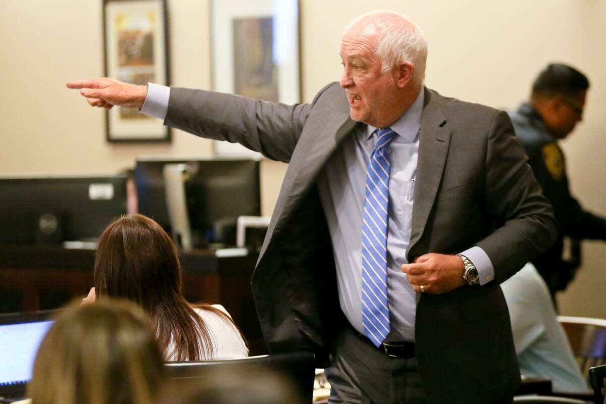 Defense attorney J. Charles Bunk cross-examines Dennis Austin (not pictured) on the witness stand during the third day of testimony in the retrial of Daniel Lopez in the 379th state District Court at the Cadena-Reeves Justice Center on Wednesday, May 30, 2018. Lopez is accused with two others of beating, dismembering and burning body parts of his girlfriend's cousin, Jose Luis Menchaca, in retaliation over a stabbing in a drug deal gone bad. MARVIN PFEIFFER/mpfeiffer@express-news.net