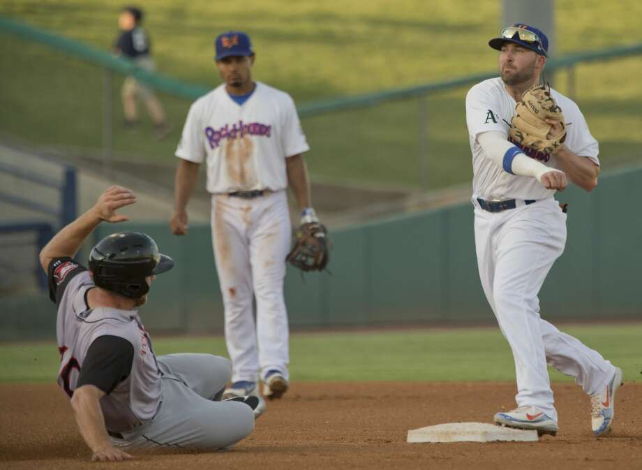 RockHounds' J.P. Sportman gets the force out at second on Travelers Joe DeCarlo and completes the double play at first 05/31/18 at Security Bank Ballpark. Tim Fischer/Reporter-Telegram Photo: Tim Fischer/Midland Reporter-Telegram