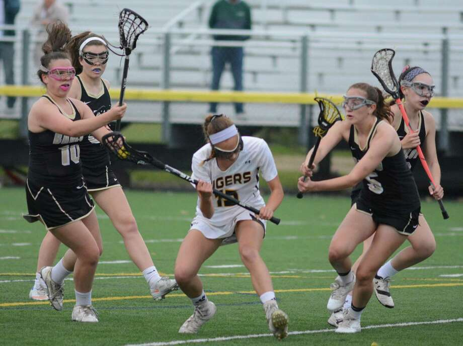 Hand's Dory Howard is surrounded by Barlow's Ava DiZenzo (5) and Molly Carroll (10) during Thursday's Class M quarterfinal. Photo: Dave Phillips / For Hearst Connecticut Media