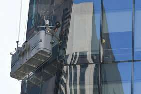 Window washers work on the side of 535 Mission St. in San Francisco. Washing high-rise windows is a booming business.