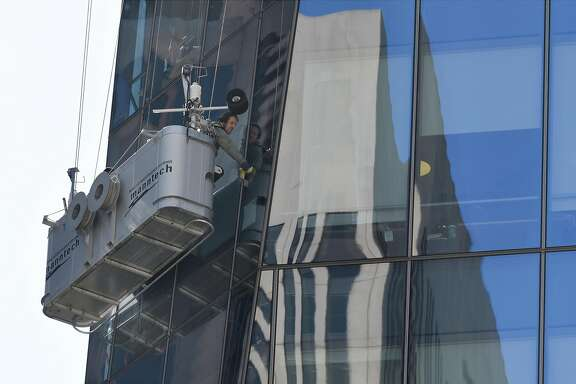 Window washers work on the side of 535 Mission Street, in San Francisco, Calif., on Thursday May 31, 2018.