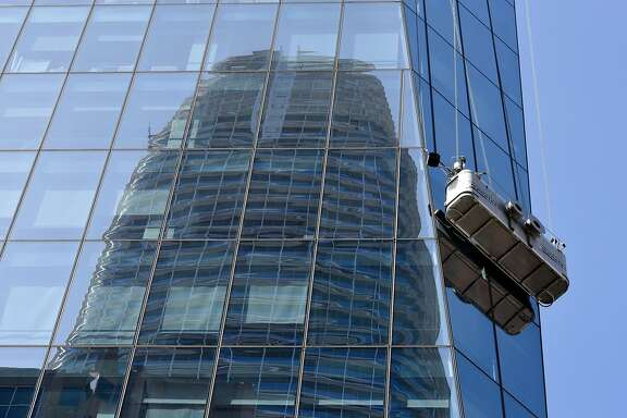 Salesforce tower is reflected in the glass of 535 Mission Street as window washers work their way down, in San Francisco, Calif., on Thursday May 31, 2018.