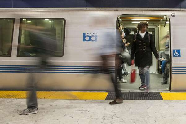 Commuters exit the Bart train at Civic Center Bart Station during the morning rush hour in San Francisco, Calif. Thursday, May 31, 2018.