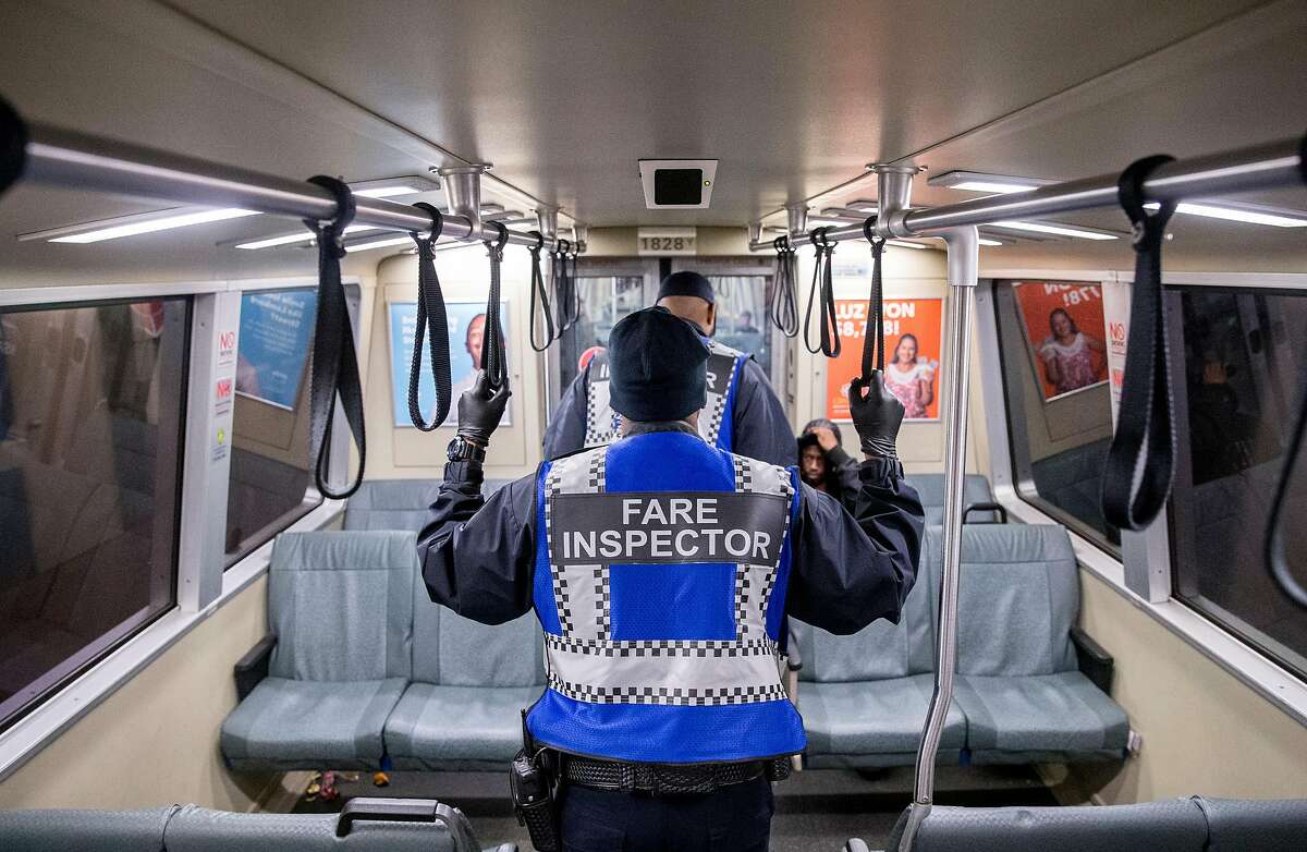 Fare Inspectors patrol a Daly City bound Bart train during the morning commute in San Francisco, Calif. Thursday, May 31, 2018.