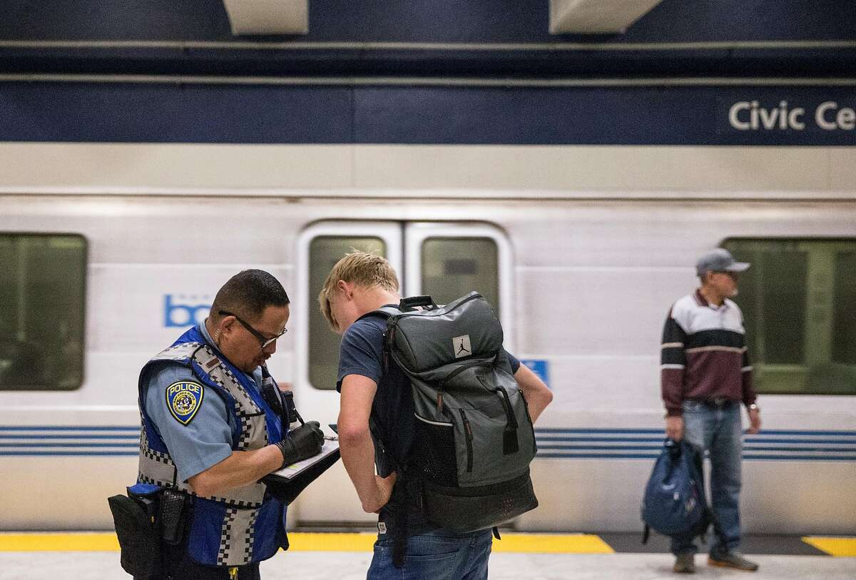A man is given a citation after failing to pay his fare at Civic Center Bart Station during the morning commute in San Francisco, Calif. Thursday, May 31, 2018.