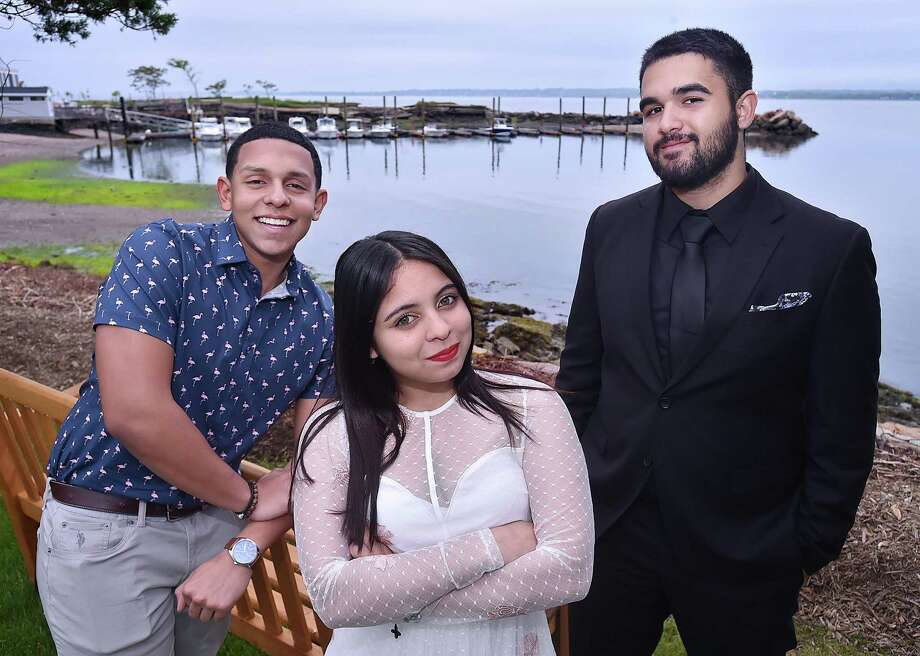 From left, New Haven high school seniors Raphyel Soto Gomez, Yeika Rivera and Gabriell Matos are this year's scholarship recipients from the New Haven Hispanic Firefighters Association. Photo: Catherine Avalone / Hearst Connecticut Media / New Haven Register