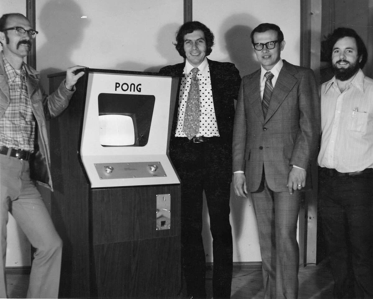"""**EDS.: RETRANSMISSION OF XNYT152 SENT ON MAY 31, 2018 TO ADD USE RESTRICTIONS** From left: Ted Dabney, Nolan Bushnell, Fred Marincic and Allan Alcorn in 1973 with a Pong console at the Atari offices in Santa Clara, Calif. Samuel """"Ted"""" Dabney, an electrical engineer who laid the groundwork for the modern video game industry as a co-founder of Atari and helped create the hit console game Pong, died on May 26, 2018, at his home in Clearlake, Calif. He was 81. (Al Alcorn/Computer History Museum via The New York Times) -- NO SALES; FOR EDITORIAL USE ONLY WITH STORY SLUGGED OBIT DABNEY BY BOWLES FOR MAY 31, 2018. ALL OTHER USE PROHIBITED."""