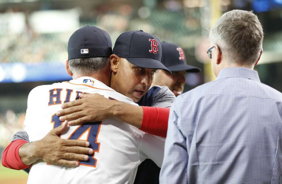 Former Houston Astros coach Alex Cora (20) hugs Astros manager AJ Hinch (14) after he and Craig Bjornson (53) recieved their World Series rings from Jeff Luhnow before the start of an MLB baseball game at Minute Maid Park, Thursday, May 31, 2018, in Houston. ( Karen Warren  / Houston Chronicle ) Photo: Karen Warren/Houston Chronicle