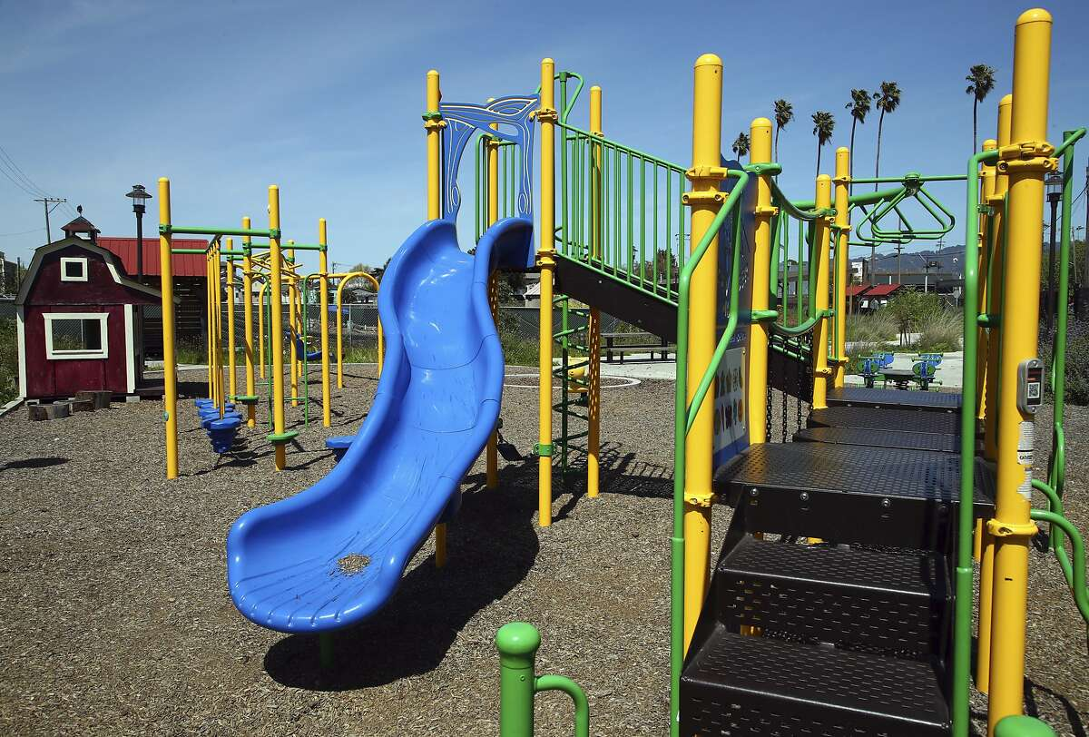 ADVANCE FOR USE SATURDAY, MAY 4, 2018 AND THEREAFTER-This Friday, April 13, 2018 photo shows a children's play area at the West Oakland Park and Urban Farm in Oakland, Calif. Proposition 68 would authorize $4 billion in bond funding for parks and water infrastructure, including $725 million to build parks in underserved neighborhoods. (AP Photo/Ben Margot, File)