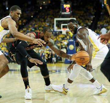 4638b86a17ec 1of2Golden State Warriors  Draymond Green knocks the ball loose from Cleveland  Cavaliers  LeBron James in the third quarter during game 1 of The NBA  Finals ...
