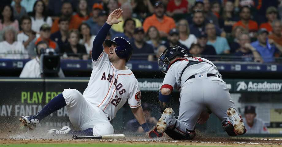 Houston Astros J.D. Davis (28) beats the throw to score a run at home against Boston Red Sox catcher Sandy Leon (3) during the fourth inning of an MLB baseball game at Minute Maid Park, Thursday, May 31, 2018, in Houston. ( Karen Warren  / Houston Chronicle ) Photo: Karen Warren/Houston Chronicle